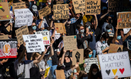 Protesters participate in a Black Lives Matter rally in Brisbane, Australia, June 6, 2020. AAP Image/Glenn Hunt via REUTERS ATTENTION EDITORS - THIS IMAGE WAS PROVIDED BY A THIRD PARTY. NO RESALES.